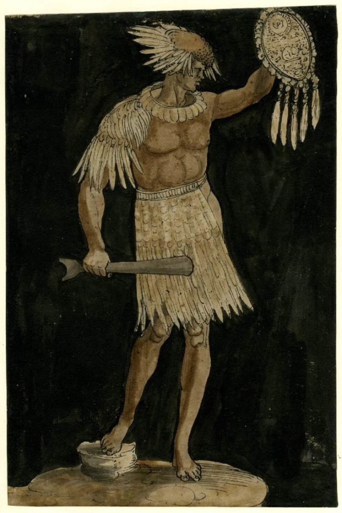 Young man wearing feather skirt and a shield