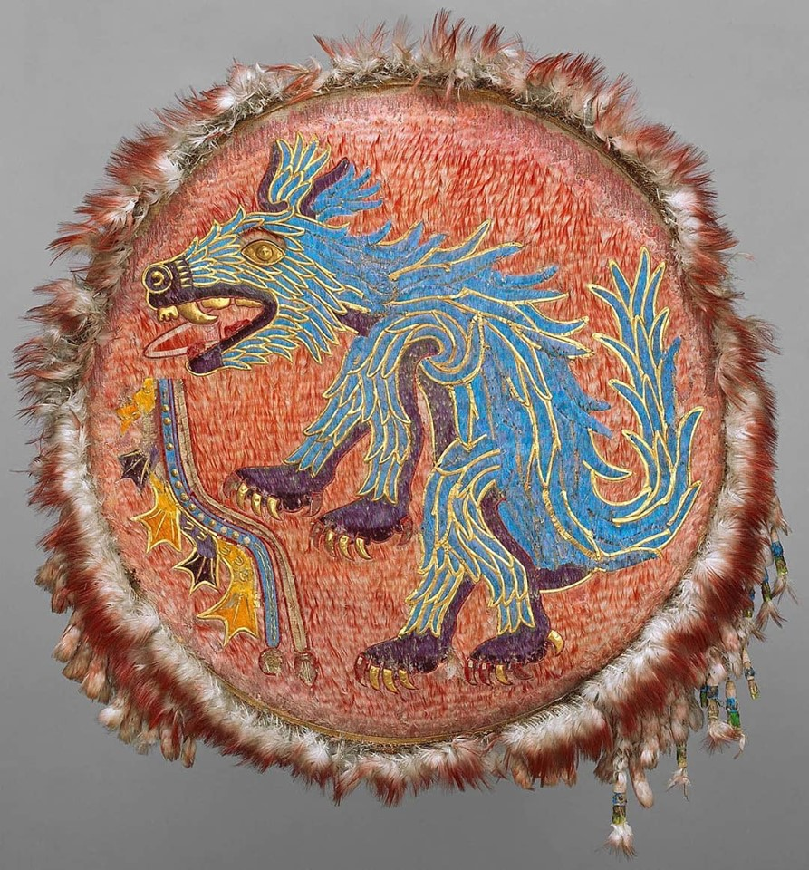 Aztec feathered shield with a blue creature